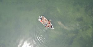 overhead shot of a fishing boat in shallow water