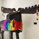 Montgomery the moose adorned in a rainbow flag
