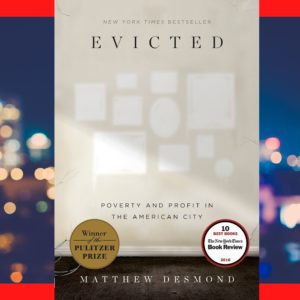"""The cover of the book """"Evicted"""" by Matthew Desmond against blurred city lights"""
